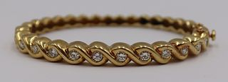 JEWELRY. 18kt Gold and Diamond Hinged Bracelet.