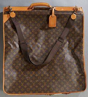 Louis Vuitton Hanging Folding Garment Bag, in brown and tan monogram coated canvas, opening to a brown nylon interior with multiple zipper compartment