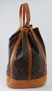 Louis Vuitton Brown Monogram Coated Canvas GM Randonnee Shoulder Bag, the exterior with vachetta leather bottom and adjustable straps and golden brass