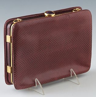 Vintage Judith Leiber Maroon Lizard Clutch, with dual compartments and gold tone hardware, with two cabachon amethyst snap closures, the first interio