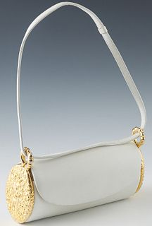 Vintage Judith Leiber White Leather and Gold Barrel Handbag, the flap with a push gold brass button clasp, opening to an open interior lined with ivor