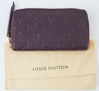 Louis Vuitton Dark Purple Monogram Empreinte Secret Wallet, the calf leather with golden accent zipper to leather pull, opening to two bill compartmen