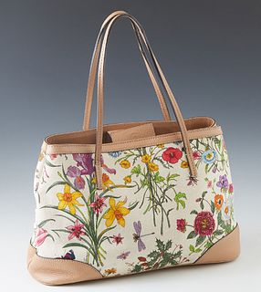 Gucci White MC Canvas Floral Shoulder Bag, with tan leather accents and magnetic closure, the interior of the bag lined in beige canvas with a side zi
