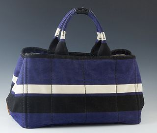 Prada Black, Navy and White Fabric Tote Bag, with double handes, the interior of the bag lined in beige canvas, one side with a zip closure pocket, th