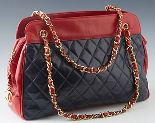 Chanel Black and Red Lambskin Chain Shoulder Bag, with gold tone hardware and zip closure, the interior of the bag lined in red leather with two zip c