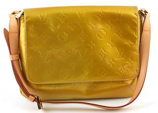 Louis Vuitton Golden Yellow Thompson Street Shoulder Bag, with golden brass hardware and adjustable vachetta leather strap, opening to a grey calf lea