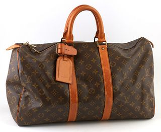 Louis Vuitton Brown Monogram Coated Canvas 45 Keepall Travel Bag, the vachetta leather straps and luggage tag with golden brass hardware, opening to a