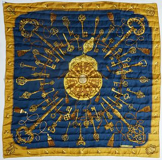 Hermes Les Clefs Silk Scarf, first issued in 1965, with a lock and key motif on a navy background, with hand rolled edges, H.- 36 in., W.- 36 in.