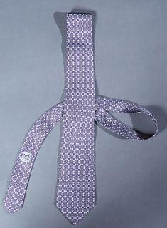 Hermes Men's Silk Tie, with an interlocking geometric motif on purple background, L.- 62 in.