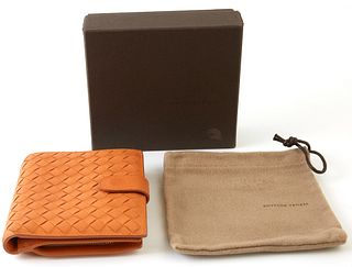 Bottega Veneta Orange Bifold Wallet, the calf leather intrecciato with gold accents, opening to two card holders, three bill compartments, and a side