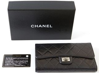 Chanel Reissue Bifold Black Wallet, c. 2006-2008, the calf leather quilted with brushed silver accents, opening to four bill compartments, one coin po