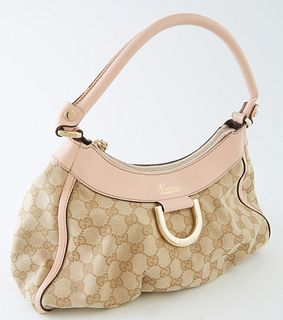 Gucci Powder Pink Leather and Beige Monogramed Canvas PM D-Ring Hobo Handbag, the exterior with gold hardware, opening to a brown interior with side z