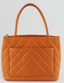 """Chanel Mandarine Caviar Quilted Leather Medallion Shoulder Bag, with large """"CC"""" logo sewn on front and golden brass zip chain with """"CC"""" logo, opening"""