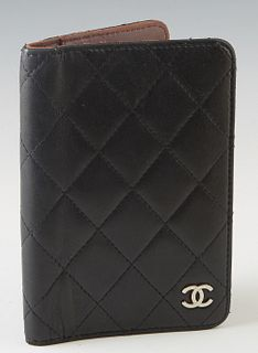 Chanel Black Lambskin Small Agenda Case, c. 2009, with a silver CC logo on front, the interior lined in dark brown leather with three open storage slo