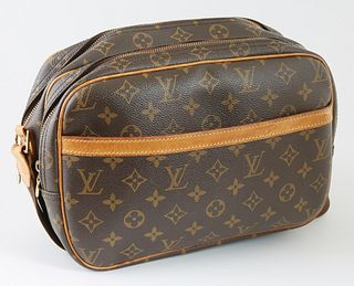 Louis Vuitton Brown PM Monogram Coated Canvas, the vachetta leather trim and accents with brown canvas adjustable shoulder strap, the front with an op