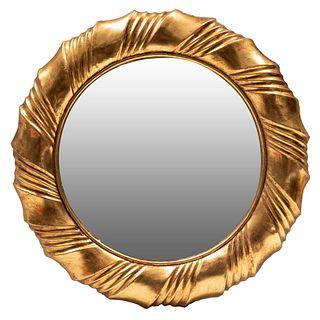 Espejo. SXX Diseño circular. Elaborado en madera y pasta dorada. Con luna circular. Decorado con elementos orgánicos. 82 cm diámetro