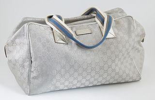 Gucci Silver Monogrammed Canvas Collapsible Carry-On Duffle Bag 40 Shoulder Bag, with blue, grey and white canvas straps, the top zip opening to a bla