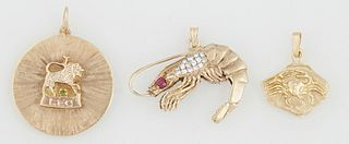 "Group of Three 14K Yellow Gold Pendants, consisting of a shrimp mounted with a red stone and small round diamonds; a ""Leo"" zodiac pendant mounted with"