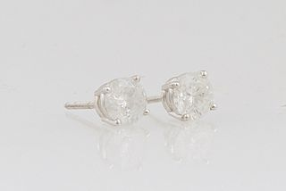 Pair of 14K White Gold Diamond Stud Earrings, each with a .53 ct. round diamond on a screwback post, total diamond wt.- 1.06 cts., with appraisal.