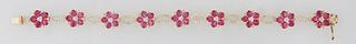 """14K Yellow Gold Link Bracelet, the nine floriform links with oval ruby """"petals,"""" around a center mounted with three round diamonds, joined by nine ova"""