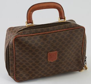 Celine Brown Macadam Coated Canvas Toiletry Bag, the exterior with a brown leather Celine emblem, a brown leather handle with golden brass hardware an