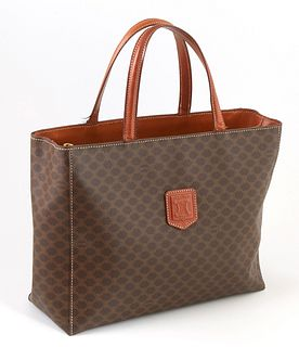 Celine Brown Macadam Coated Canvas Logo Handbag, the exterior with brown leather emblem and handles, opening to two brown lined open interiors with on