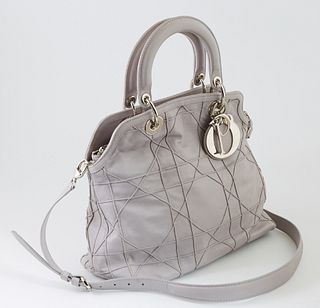 Christian Dior Granville Lilac Calf Leather Tote, with silver hardware, the interior of the bag lined in grey nylon, one side of the bag with two open