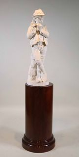 Carved Marble Sculpture of a Boy Playing Flute