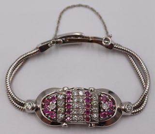 JEWELRY. Bulova 14kt Gold, Ruby and Diamond Watch.