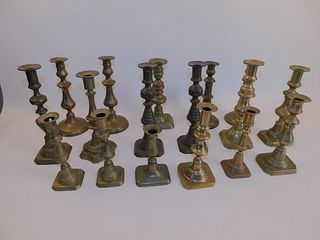 17 ANTIQUE BRASS CANDLE HOLDERS