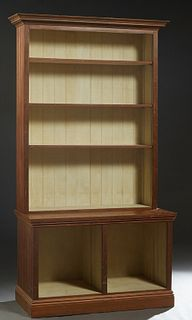 Louisiana Carved Cypress Bookcase, 20th c., the stepped crown over open shelves with beaded board sides, on a like base, on a stepped plinth, H.- 95 i