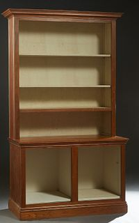 Cypress Bookcase, 20th c., the stepped crown over a top with beaded board sides and adjustable shelf standards, on a beaded board base with open adjus