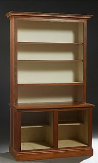 Louisiana Carved Cypress Bookcase, 20th c., the stepped crown over open shelves, flanked by beaded board sides, on a base with open storage and beaded