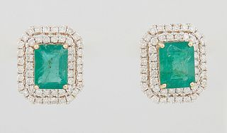 Pair of 14K Yellow Gold Stud Earrings, each with a 1.76 ct. emerald atop a double concentric graduated border of round diamonds, total emerald wt.- 3.