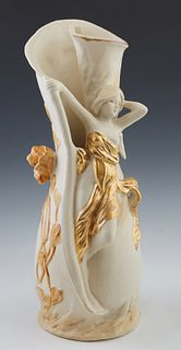 Royal Dux Art Nouveau Vase, 20th c., the rolled cylindrical white body, with relief blooming foliage surrounding the maiden covered in a green wrap wi