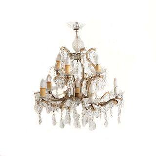 Candil. Siglo XX. Estilo María Teresa. Elaborado en cristal y metal. Para 11 luces. Con arandelas florales.