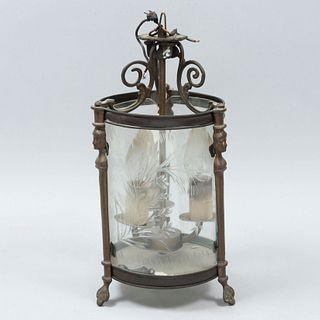 Lámpara de techo. Siglo XX. Elaborada en metal. Para 3 luces. Con pantalla cilíndrica de cristal. Decorada con elementos florales.