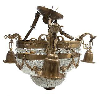 Lámpara de techo. Siglo XX. Estilo Imperio. Elaborada en bronce. Para 4 luces. Con arandelas florales. 44 cm altura