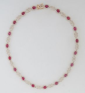 14K Yellow Gold Link Necklace, the nineteen links mounted with an oval ruby atop a border of round diamonds, joined by pierced diamond mounted double