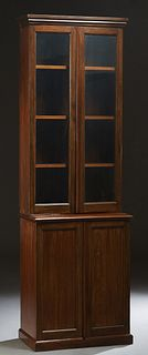 English Carved Mahogany Slender Bookcase Cupboard, early 20th c., the stepped crown over a double glazed door bookcase, on a stepped base with double