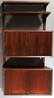 Mid Century Modern Carved Rosewood Bookshelf, 20th c., with two open adjustable shelves, above a double sliding door cupboard, to a lower fall front d