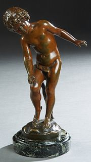"After Auguste Moreau (French), ""Boy Playing Marbles,"" early 20th c., patinated bronze, on a stepped verde antico circular base, H.- 10 1/2 in., W.- 6"