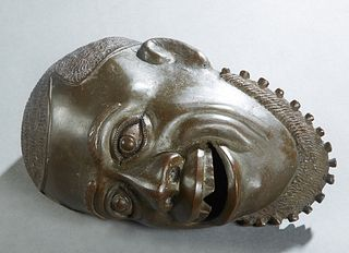 African Patinated Bronze Head of a Man, 20th c., H.- 5 in., W.- 7 in., D.- 10 3/4 in.