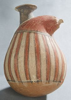 "Polychromed and Fired Terracotta Gourd Vessel, 900-1400, Peru, with a flared top spout, the red gourd top scored around the ""stem"" end, the body with"