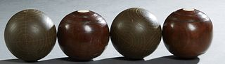 Group of Four English Wooden Bocce Balls, early 20th c., two of rosewood with two inset circular ivory plaques; and two with incised decoration, Dia.-