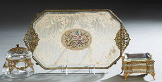 Group of Three Lady's Dresser Items, early 20th c., consisting of a brass and glass ring box with a tufted silk interior; a brass filigree mounted gla