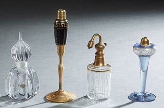 Group of Four Glass Perfume Bottles, 20th c., consisting of a Baccarat atomizer; a tall black glass and brass atomizer; a graceful pale blue gilt deco