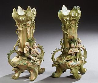 Pair of German Polychromed Figural Bisque Flare Vases, late 19th c., Saxony, the pierced scalloped rims over tapered baluster bodies with applied hand