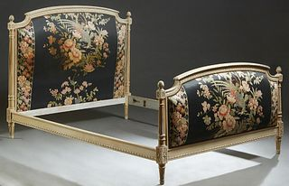 French Louis XVI Style Polychromed Beech Double Bed, 20th c., the arched upholstered cushioned headboard on turned tapering reeded supports with pinea