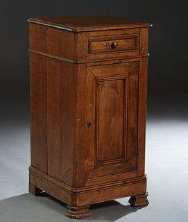 French Provincial Louis Philippe Carved Poplar Nightstand, 19th c., the stepped canted corner top over a frieze drawer and a long cupboard door, on a